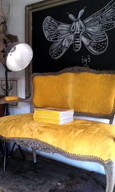 yellow cowhide love seat....beautiful color