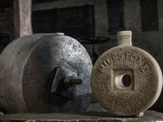 The bottle of MILESTONE, a re-creation of an authentic old millstone, is lovingly made by experienced potters, working to create this traditional stoneware clay, which meets today's health and safety standards.