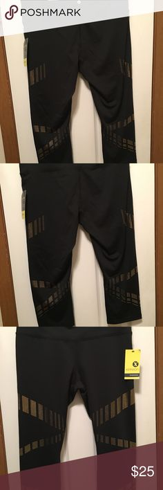 Work out outfit. Top and bottom. Brand new w/ tags. The pants are black with gold, Size Large and the top is a Gold Shine that is XL. Will not split. Xersion Pants Capris