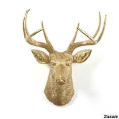 Deers head faux animal taxidermy The Franklin by White Faux Taxidermy.Gold resin faux deer head. The bone structure and features are very visible and make it look even more real. The eyes, nostrils and ears are almost lifelike. Gold has often been associated with decadence, opulence and status. Add a little fancy to your stag deer with our metallic gold!
