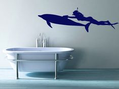 Female Scuba Diver Swimming with a Dolphin  by VinylWallAdornments, $45.00