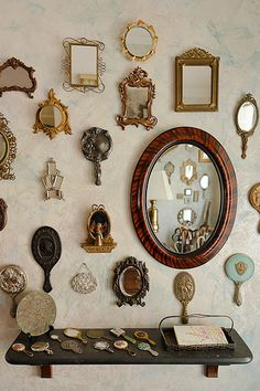 I love how a wall of mirrors look.  These vintage ones are wonderful!