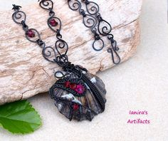 OOAK Black wire wrapped seashell pendant with Swarovski by Ianira