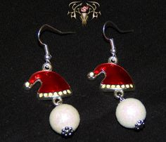Check out this pair of Santa Hat Earrings for only $9.99 at www.twistedthingamajigs.com. Come on and see us and start getting festive with us!