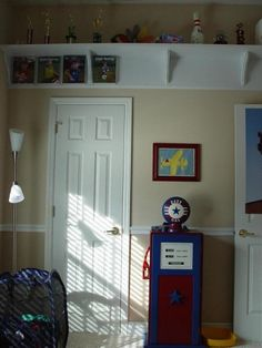 Love the high shelf with picture and trophy!!! boys room idea shelf with room for pictures
