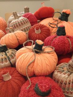 Thrift store fall sweaters + stuffing + gardening jute twine = super cute, easy, and cheap no-sew pumpkin decorations.