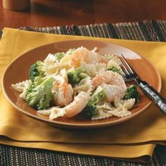 Caesar Shrimp and Pasta... I don't use a creamy dressing for this.  I also add in a shake of crushed red pepper flakes and mozzarella cheese.  It's one of hubby's favorites!