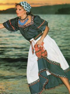 Yves Saint Laurent- 1977 Navy cotton blouse lined in rickrack and white skirt with pom-pom bordered braid.  L'officiel USA Spring 1977