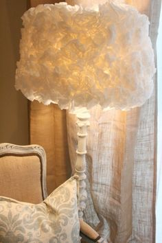 "DIY Coffee Filter Lamp Shade | Shelterness ~The process is simple yet time consuming. Fold each filter in quarters, bend the tip and apply hot glue to the tip. Glue it and many many other ""flowers"" to the lamp shade frame. The top and bottom of shade should have the edges of the flowers pointing away from the shade's edge. After you've done you'll get a really beautiful mood lamp."