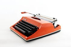 Manual typewriter from the 70s made in Germany. Its good working condition and has intensive orange color and German keyboard QWERTZ. Types nicely in black and red. .This typewriter comes with a hard plastic black case and very usefull on journey or everyday. It will be perfectly decor in home or great vintage collectible item.  ------------------------------------------------------------------------- Please feel free to convo me with any questions…