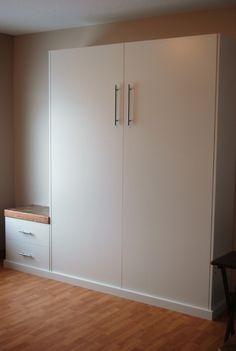 Custom Wall Beds - http://www.custommurphybeds.com/ (call for quote)