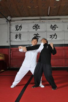 Grandmaster Willy Lin demonstrating kung fu technique on Shifu Billy Greer, owner of Jing Ying Institute of Kung Fu & Tai Chi.