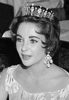 Elizabeth again in Paris in February, 1958 with the Todd tiara and Diamond ear pendants.