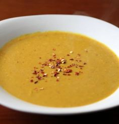 Spicy Thai Pumpkin Soup - this pumpkin soup is made with coconut milk, curry powder, crushed red pepper and canned pumpkin. So easy and ready in just 20 minutes!