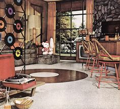 Not really something I can buy...but I would so love to have a rec room styled like this, with the vinyl LP room divider, bamboo tiki bar, and leopard print couch. Oh, and the portable record player too!