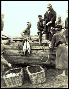 UNLOADING THE CATCH -- A Happy Fisherman and His Friends on the Shores of OLD JAPAN