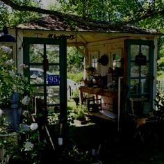 Repurposing doors and windows into potting shed/garden room