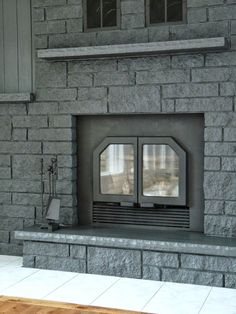 """Dans le Lakehouse: Fireplace Before + After, color Behr """"Evening Hush"""" satin. Painted Stone Fireplace, Stone Fireplace Makeover, Painted Brick Fireplaces, Fireplace Doors, Fireplace Update, Paint Fireplace, Concrete Fireplace, Fireplace Remodel, Fireplace Design"""