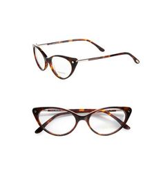 """For defined cheekbones, shop for glasses that are smaller in length and have upturned corners, says Turen. """"The cat eye shape gives the illusion of an instant facelift and will highlight your bone structure."""" An edgy pair of Tom Ford Eyewear Modern Cat's-Eye Plastic Eyeglasses ($385, saksfifthavenue.com) is perfect for a fashion-forward woman.  - GoodHousekeeping.com"""