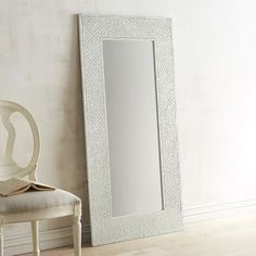 Prepare to be dazzled. It's inevitable with our Blanc mirror and its countless glass mosaics. It's more furniture than mere mirror, specially designed and handcrafted to bring a shine to your surroundings. Position it in a space where it can reflect light, and watch it transform the room.