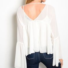 NWT white top. Available in small. I have 2 smalls available in this top! I can do next day shipping! Tops Blouses