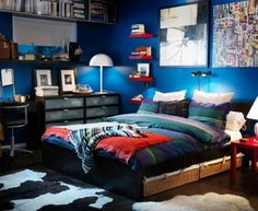 excellent small teen boy bedroom design with cool blue wall paint color and twin size bed and wicker baskets under bed also espresso wooden furnitures
