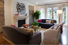 velvet sofas, white curtains, black hardware. mix of antique and modern