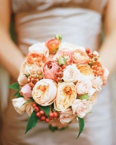 A rosy bridesmaid's bouquet accented with berries