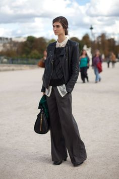 A black leather jacket looks luxe with wide-leg pants and a pretty blouse. Street Style Spring 2013 - Paris Fashion Week