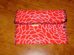 Reusable snack pouch - iron heat n bond iron vinyl to cotton; serge together into a pouch; finish with Velcro.