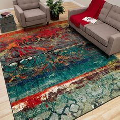 This design features a color pallet of vivid blues and vibrant oranges.The abstract pattern is a great foundation for contemporary design. This machine uses many colors to create a wonderfully designed, durable, vibrant rug that is applicable to any room.