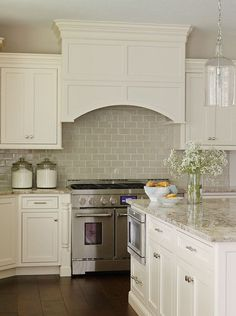 wide plank floors, glazed subway backsplash, simple cabinets and handles