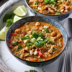 Vegetarian Thai Peanut Soup: Delectable Thai spices and creamy peanut butter, plus shiitakes and ramen noodles, flavor this hearty soup.