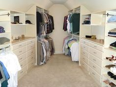 Attic storage area converted into a his-and-her shared walk in closet.