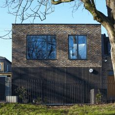 SAM+Architects+uses+recycled+brick+and+charred+wood+for+London+mews+house
