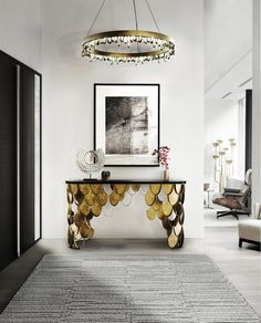 Living room decorating ideas: modern console tables to have | KOI brass foyer console table by @brabbu  | See more at http://homeinspirationideas.net/furnishings-inspiration-ideas/living-room-decorating-ideas-modern-console-tables-to-have