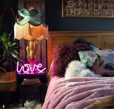 cactus lamp with fringed shade and neon love sign