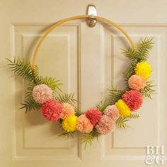 DIY Gifts : Make an Easy Pom-Pom Wreath Perfect for Every Season . Pom Pom Wreath, Diy Wreath, Wreaths, Wreath Crafts, Pom Pom Kranz, Easter Crafts, Christmas Crafts, Christmas Pom Pom, Embroidery Hoop Decor