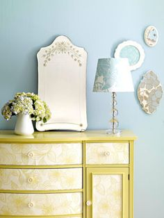 Updating a dresser with wallpaper is a great idea that I'll keep on the back-burner: there's a bit of DIY instruction here: http://www.apartmenttherapy.com/la/inspiration/hilarys-diy-wallpaper-nightstand-project-101058