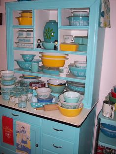 Pyrex; I would love to find this cabinet a 1940's kitchen is my dream, well one of them!;