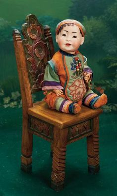 oriental baby - Theriault's Antique Doll Auctions