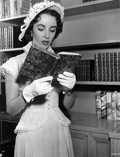 "Elizabeth Taylor reading in library. Elizabeth Rosemond ""Liz"" Taylor was a British-born American actress. From her early years as a child star with MGM, she became one of the great. Elizabeth Taylor, Golden Age Of Hollywood, Classic Hollywood, Old Hollywood, Hollywood Glamour, Hollywood Stars, People Reading, Woman Reading, Brigitte Bardot"