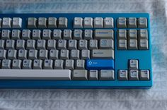 """More of LastPilot's sky blue LZ-S with these gorgeous keycaps. Some (like the """"CODE"""" and backwards-kill-word came from a Triumph Adler Satellite 4)"""