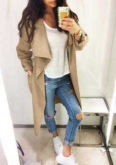 Girl in camel draped open-front long coat, cutout jeans