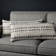 Shop Elma Black Stripe Pillows Set of Black and neutral natural fibers stitch a raised pattern of angular lines crossed with rows of dashes. Handwoven of cotton and wool, the two lumbar pillows are richly textured and exceptionally touchable.