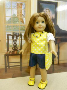 """Sunshine and Denim  Nothing says spring like yellow! This cute blouse has white, puffy sleeves set into a yellow polka-dot front and back. For ease of dressing, the back closes with Velcro. Elastic waist denim shorts have matching bows on each leg. The blue, white and yellow necklace adds a dressy touch. The purse is the perfect complement. Because a girl can't have TOO many shoes, these ARE included!  This five piece outfit is ready for the owner of a loved 18"""" doll, such as American Girl…"""