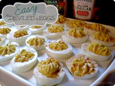 Easy Deviled Eggs recipe. Tip: Adding two tablespoons of Heinz® White Vinegar per quart of water before boiling eggs will prevent cracking, and the shells will peel off faster and easier when they're done.