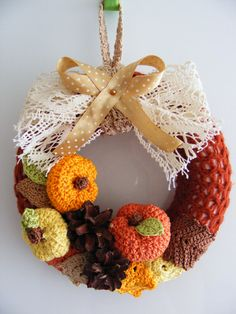 Fall wreath decoration crocheted pumpkins, leaves and real pine cones. $38.00, via Etsy.