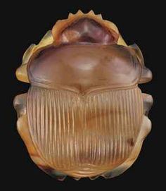 AN EGYPTIAN AGATE SCARAB -   LATE PERIOD, DYNASTY XXVI-XXX, CIRCA 664-332 B.C. -   Naturalistically modelled with finely striated wing-case, strap loop on the underside  1¼ in. (3.2 cm.) long