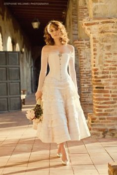 This Sweet Lili dress by Joan Shum has the bodice of a steampunk princess and the skirt similar to the (now discontinued) Fiesole by Priscilla of Boston